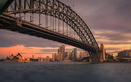 Sydney Harbour Bridge at sunset with clouds